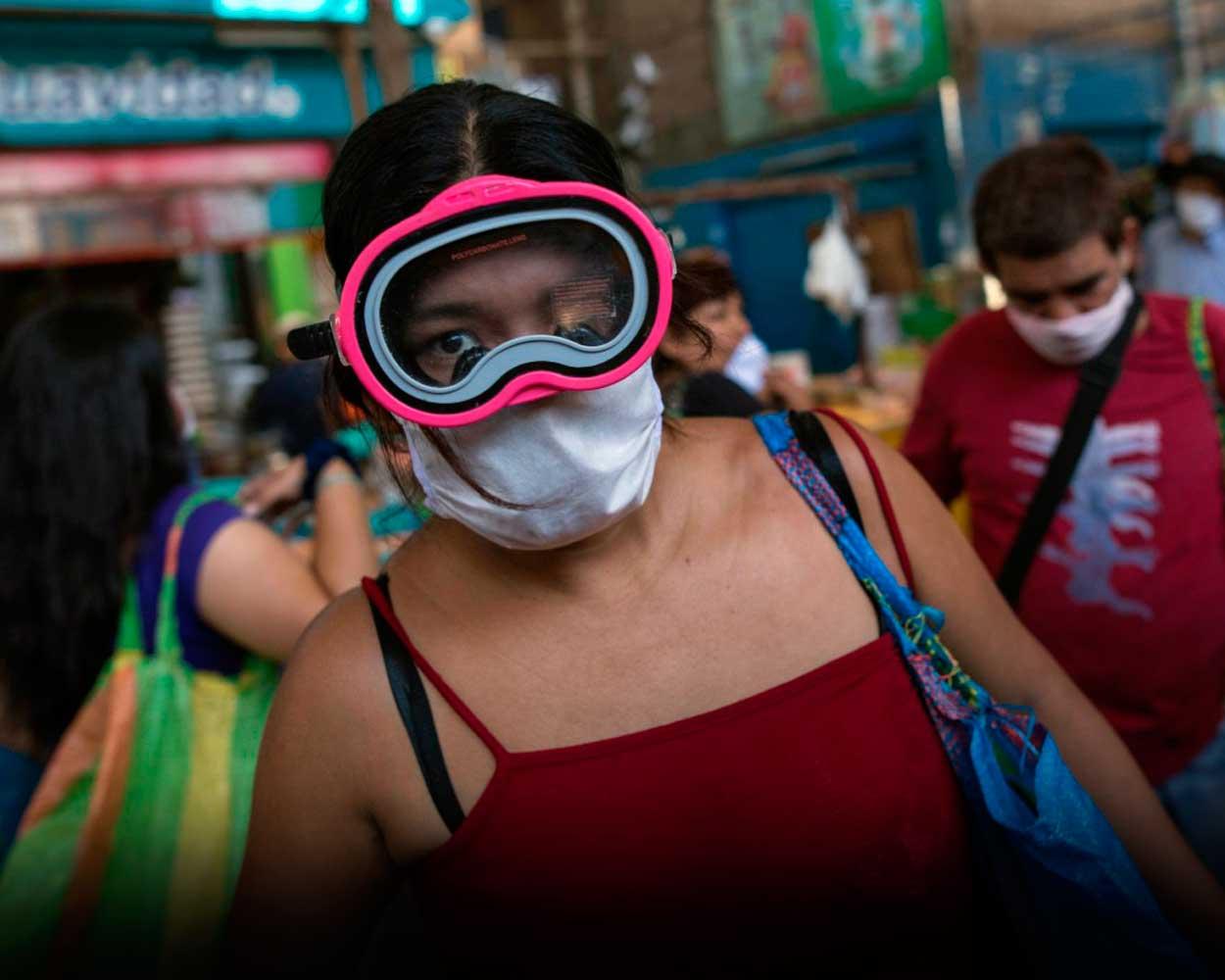 coronavirus peru lima mujer mercados